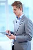 Man with touchpad — Stock Photo