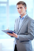 Businessman with clipboard — Stock Photo