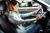 Female in new car — Stock Photo
