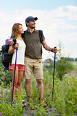 Hikers with backpacks — Stock Photo