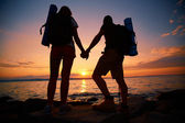 Hikers at sunset — Stock Photo