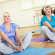 Stock Photo: Sitting on mats