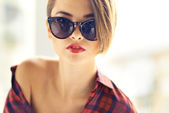 Close-up portrait of a tempting lady with her shirt slipping from one shoulder — Stock Photo