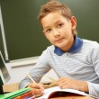Schoolboy at the desk — Stockfoto