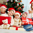 By Christmas tree — Stock Photo