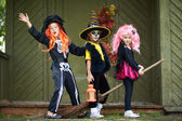 Halloween girls on broom — Stock Photo