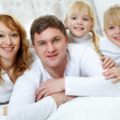 family on bed — Stock Photo