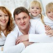 Family on bed — Stock Photo #32902041