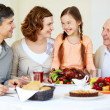 Family at Thanksgiving table — Stock Photo #32902167
