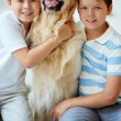 Kids and their pet — Stock Photo