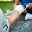 Stock Photo: Bandaging leg