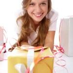 Girl among gifts — Stock Photo