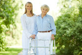 Carer and senior female — Stock Photo