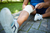 Bandaging leg — Stock Photo