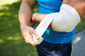 Bandaging arm — Stock Photo