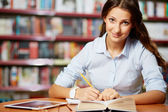 Making notes in library — Stock Photo