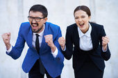 Businessman and his colleague showing their gladness — Stock Photo