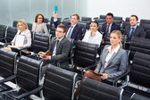 Businesspeople at seminar — Stock Photo