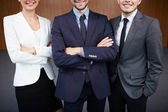 Co-workers in suits — Stock Photo