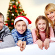 Family in Santa caps — Stock Photo