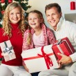 Family with gifts — Stock Photo #35271091