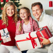 Stock Photo: Family with gifts