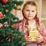 Girl by Christmas tree — Stock Photo