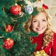 Woman with Christmas present — Stockfoto