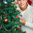 Man by Christmas tree — Stock Photo