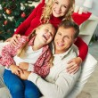 Happy family on Christmas day — Stock Photo