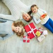 Family with giftboxes on the floor — Stock Photo #35271397