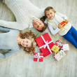 Family with giftboxes on the floor — Stock Photo