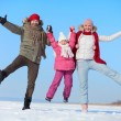 Parents and daughter having fun in winter — Foto Stock