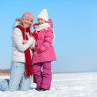 Happy woman and her daughter in winterwear — Stock Photo