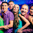 Happy girls and guys at party — Stock Photo