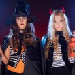 Stock Photo: Halloween females with lanterns