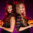 Stock Photo: Girls with carved Halloween pumpkins