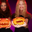 Stock Photo: Girls holding carved Halloween pumpkins