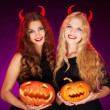 Stock Photo: Witches with horns and Halloween pumpkins