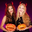 Witches with horns and Halloween pumpkins — Stock Photo #35273109