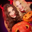 Stock Photo: Girls showing carved Halloween pumpkins