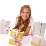 Teenager lying among giftboxes — Stock Photo