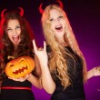 Girls with Halloween pumpkin and cocktails — Stock Photo #35273191