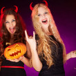 Stock Photo: Girls with Halloween pumpkin and cocktails