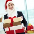 Businessman holding present in red giftboxes — Stock Photo