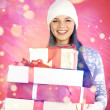 Girl with stack of giftboxes — Stock Photo #35273865