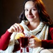 Pretty female holding glass of hot tea — Stock Photo