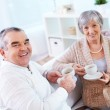 Mature man and his wife drinking tea — Stock Photo