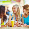 Girls chatting while having drink — Stock Photo