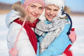 Happy woman and her son in winterwear — Stock Photo